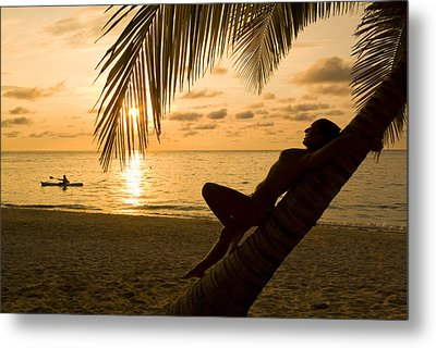 Woman Resting On A Palm Tree At Sunset Metal Print by Richard Nowitz