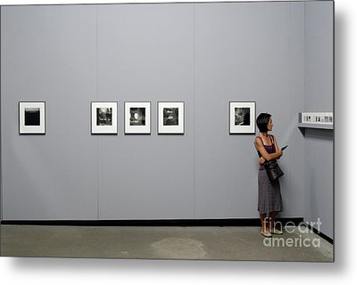 Woman Watching Photos At Exhibition Metal Print by Sami Sarkis
