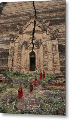 Young Buddhist Monks Near A Ruined Metal Print by Paul Chesley