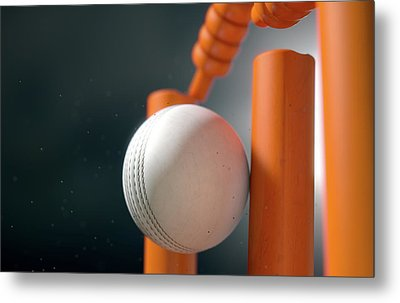 Cricket Ball Hitting Wickets Metal Print by Allan Swart