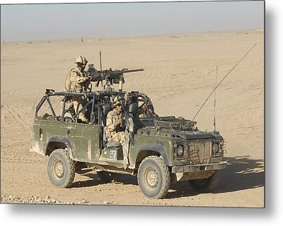 Gurkhas Patrol Afghanistan In A Land Metal Print by Andrew Chittock