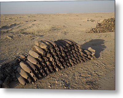 Inert Artillery Shells Are Stacked Metal Print by Terry Moore