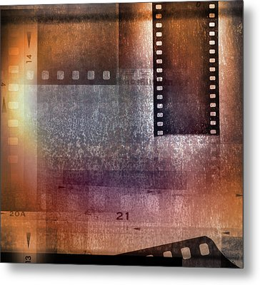 Film Strips Metal Print by Les Cunliffe