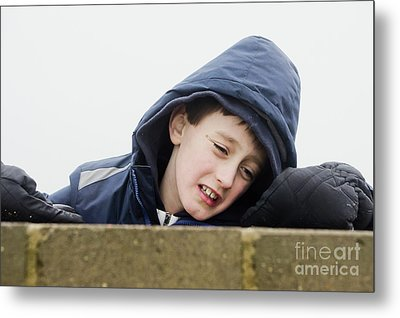 An Upset Child Metal Print by Tom Gowanlock