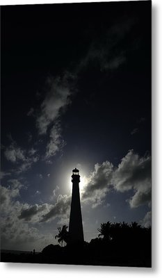 A Backlit View Of A Lighthouse Built Metal Print