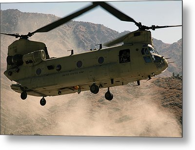 A Ch-47 Chinook Helicopter Kicks Metal Print by Stocktrek Images