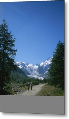 A Couple Walks Toward The Morteratsch Metal Print by Taylor S. Kennedy