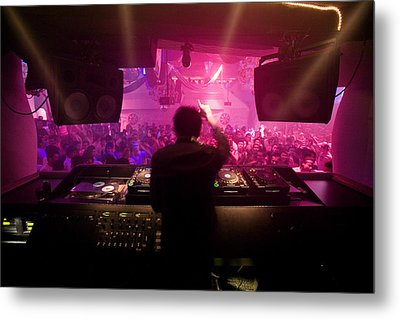 A Dj Plays To His Crowds On A Busy Metal Print by Justin Guariglia