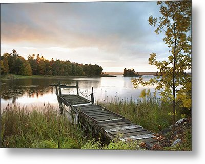 A Dock On A Lake At Sunrise Near Wawa Metal Print