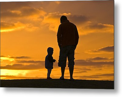 A Father And His Baby Son Watch Metal Print by Jason Edwards