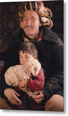 A Kazakh Eagle Hunter And His Son Metal Print by David Edwards