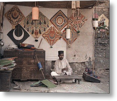 A Kite Merchant Sits In His Store Metal Print by Gervais Courtellemont
