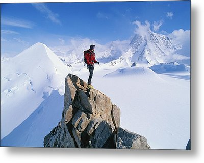 A Mountain Climber Summits Mount Metal Print