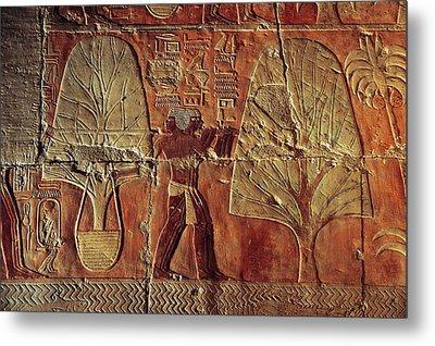 A Relief Of Men Carrying Myrrh Trees Metal Print by Kenneth Garrett