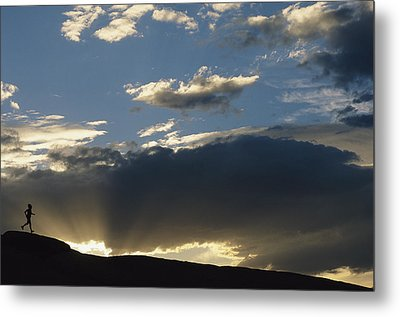 A Silhouetted Figure Trail Running Metal Print by Bobby Model