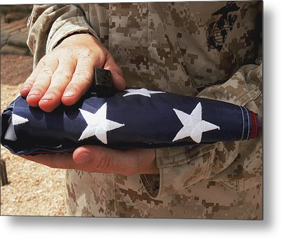 A Soldier Holds The United States Flag Metal Print by Stocktrek Images