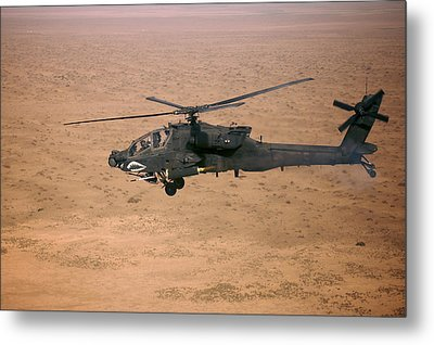 An Ah-64d Apache Longbow Fires A Hydra Metal Print by Terry Moore