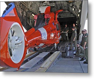 An Aircrew Loads A Coast Guard Hh-65 Metal Print by Stocktrek Images
