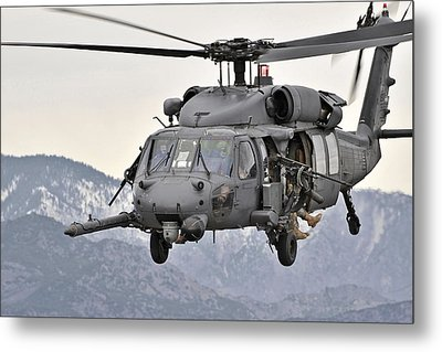 An Hh-60 Pave Hawk Helicopter In Flight Metal Print by Stocktrek Images