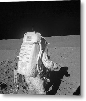 Astronaut Walking On The Moon Metal Print by Stocktrek Images