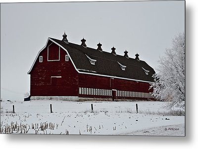 Big Red Barn In The Winter Metal Print by Edward Peterson