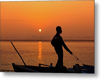 Metal Print featuring the photograph Boatsman On The Ganges by Stefan Nielsen