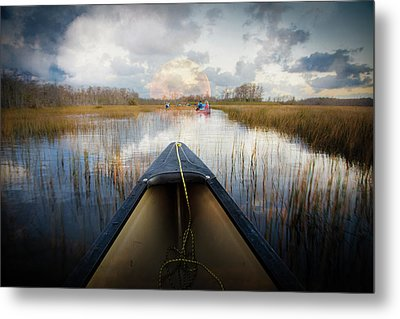 Canoeing Into Moonlight Metal Print by Debra and Dave Vanderlaan