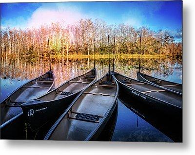 Canoes On The River Metal Print by Debra and Dave Vanderlaan