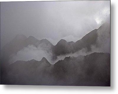 Cloud Shrouded Machu Picchu Metal Print by Michael Melford