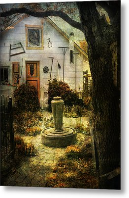 Courtyard And Fountain Metal Print by John Rivera