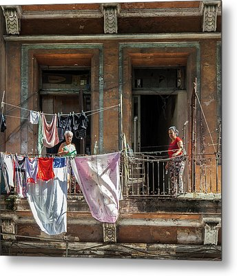 Metal Print featuring the photograph Cuban Women Hanging Laundry In Havana Cuba by Charles Harden