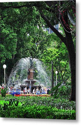 Metal Print featuring the photograph Fountain Through The Trees By Kaye Menner by Kaye Menner
