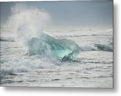 Glacial Iceberg In Beach Surf. Metal Print by Andy Astbury