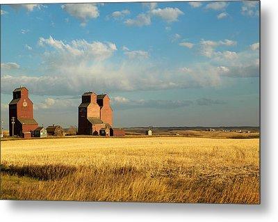 Grain Elevators Stand In A Prairie Metal Print