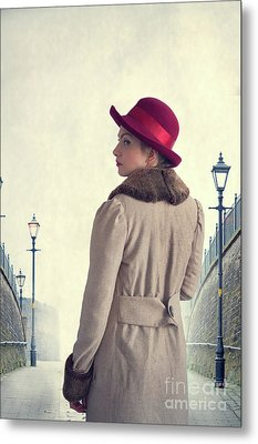 Metal Print featuring the photograph Historical Woman In An Overcoat And Red Hat by Lee Avison