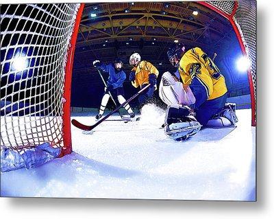 Ice Hockey Battle Through The Cage Metal Print by Elaine Plesser