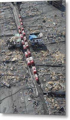 Japanese Fire Trucks Line A Road Metal Print by Stocktrek Images