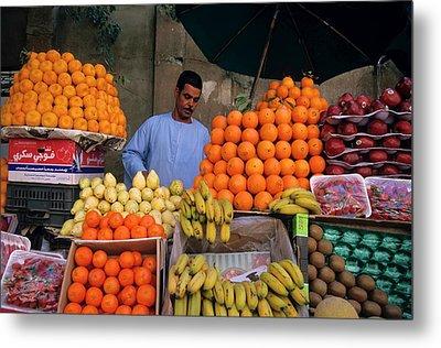 Market Vendor Selling Fruit In A Bazaar Metal Print by Sami Sarkis