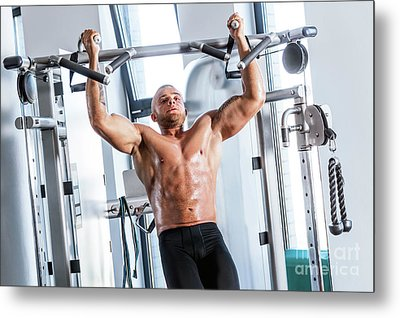 Muscular Strong Man Working Out At A Gym. Metal Print by Michal Bednarek