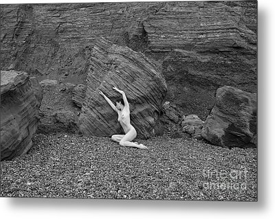 Nude Woman Pulling Shape By Rocks Metal Print