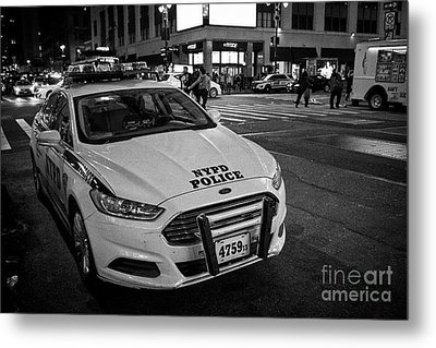 nypd ford fusion police cruiser parked on the street at night New York City USA Metal Print