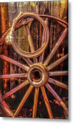 Old Wheel And Rope Metal Print
