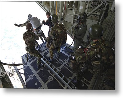 Paratroopers Jump From A C-130 Hercules Metal Print by Andrew Chittock
