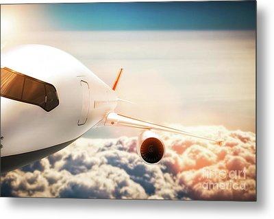 Passenger Airplane Flying At Sunshine, Blue Sky. Metal Print by Michal Bednarek