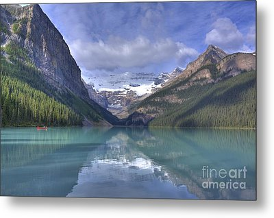 Red Canoe On Lake Louise Metal Print by Larry Whiting