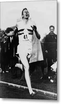 Roger Bannister Crossing The Finish Metal Print by Everett