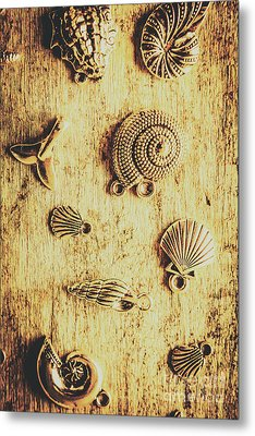 Seashell Shaped Pendants On Wooden Background Metal Print by Jorgo Photography - Wall Art Gallery