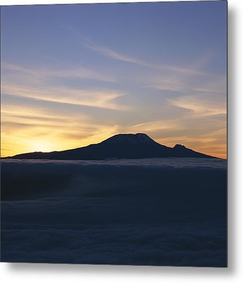 Silhouette Of Mount Kilimanjaro Metal Print by David Pluth