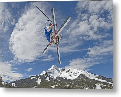 Skiing Aerial Maneuvers Off A Jump Metal Print by Gordon Wiltsie
