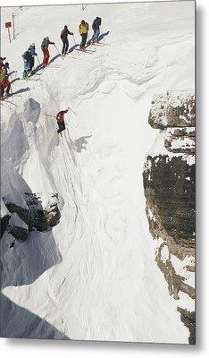 Skilled Skiers Plunge More Than 15 Feet Metal Print by Raymond Gehman